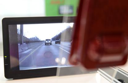 A drive camera from South Korea's GT points at a video of a road during a demonstration at Ceatec 2013 in Japan on October 2, 2013