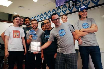 The Atlassian team celebrate an earlier award ...
