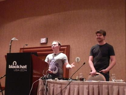 MWR InfoSecurity researchers Jon Butler and Nils presenting mobile POS flaws at Black Hat USA 2014