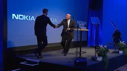 Nokia interim CEO Risto Siilasmaa and Microsoft CEO Steve Ballmer announce Microsoft's plan to acquire Nokia's mobile devices business at a news conference in Espoo, Finland
