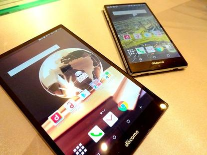 Sharp mobile devices shown off May 25, 2015, in Tokyo include a 7-inch tablet (left) weighing only 213 grams, and an Aquos smartphone that can play back slow motion video at up to 2,100 frames per second.