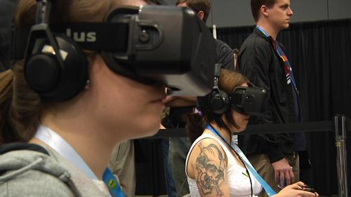 Visitors to the Game Developer Conference in San Francisco tries out an Oculus Developer Kit 2 headset on March 19, 2014