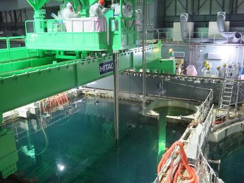 Tepco workers remove fuel rods at the Fukushima Daiichi nuclear plant using a Hitachi fuel handling machine in this November 18, 2013 photo by operator Tokyo Electric Power.