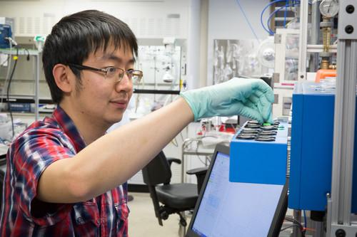 Stanford University grad student Yiyang Li tests lithium ion coin cell batteries at the Stanford Institute for Materials & Energy Sciences (SIMES).