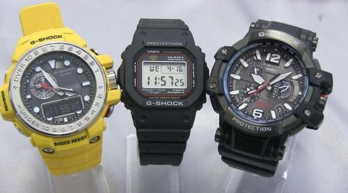Casio's 30th anniversary re-edition of the original G-Shock rugged watch (center) is flanked by the G-Shock Gulfmaster (left), which has an atmospheric pressure sensor, and the G-Shock Gravitymaster (right), which receives timekeeping signals from terrestrial radio sources and GPS satellites.