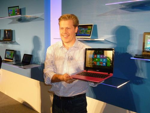 Nick Parker, vice president of OEM partnerships at Microsoft, shows off a new 2-in-1 laptop and tablet from HP at Computex 2014 in Taipei