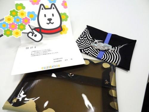 "Themed telegrams offered by Japan's PS Communications include (clockwise from top left) SoftBank's popular dog mascot, a designer ""furoshiki"" cloth and a clutch purse by Junko Koshino, a fashion designer."