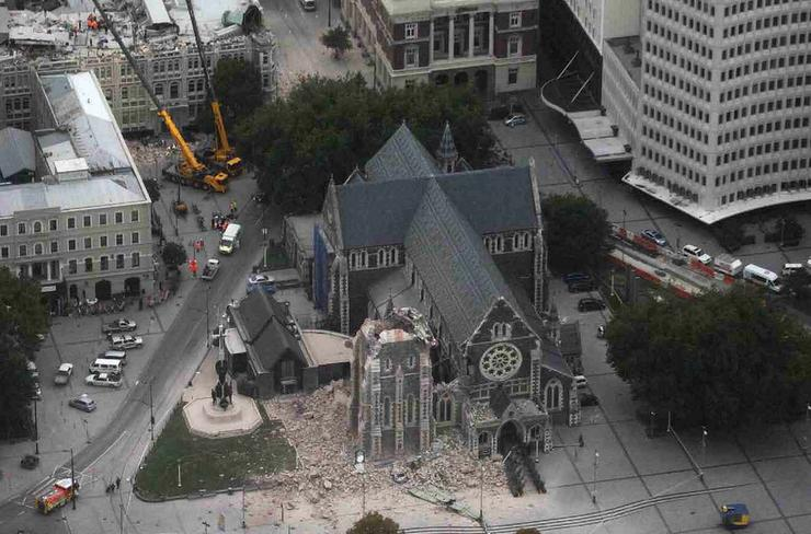 Christchurch Cathedral and the Christchurch Press building (top) devastated after the 2011 earthquake.