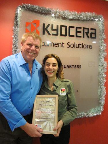 Kyocera managing director, David Finn receiving certificate of appreciation from Rainforest Rescue's Kristin Channing.