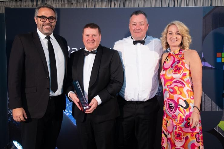 Focus Technology CEO Rod Sinclair, second from left, collected the growth partner of the year award from Lenovo last week.