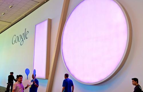 Attendees walk past the Google I/O sign at the event in the Moscone Center in San Francisco.