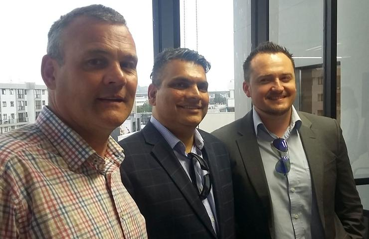 Connector Systems' Mark Dasent, left, with CyberPower's Vikas ​Chakranarayan and Brad Andrews.