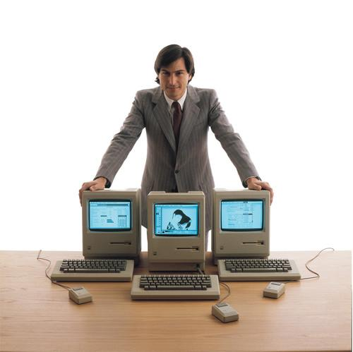 Steve Jobs with Mac computers