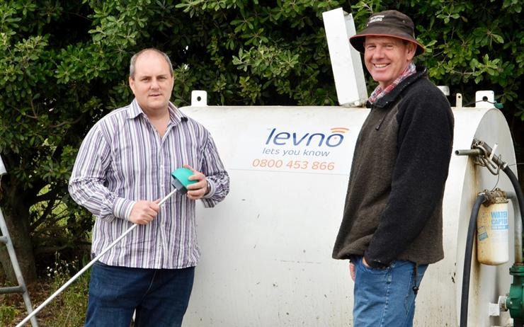 L-R: Ray Connor, CEO of Levno, and farmer James Griffin with one of Griffin's fuel tanks
