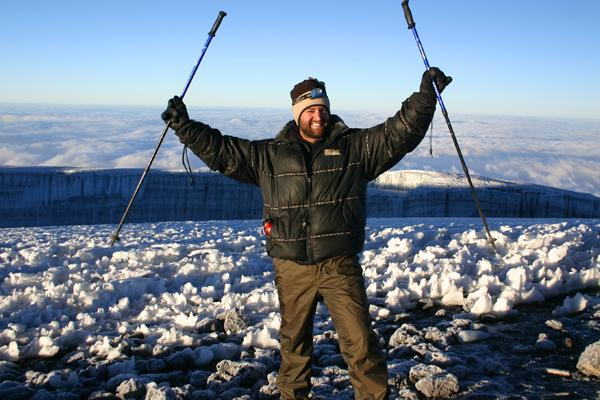 On top of the world: Thomas Duryea's Andrew Thomas celebrates reaching the summit of Mt Kilimanjaro
