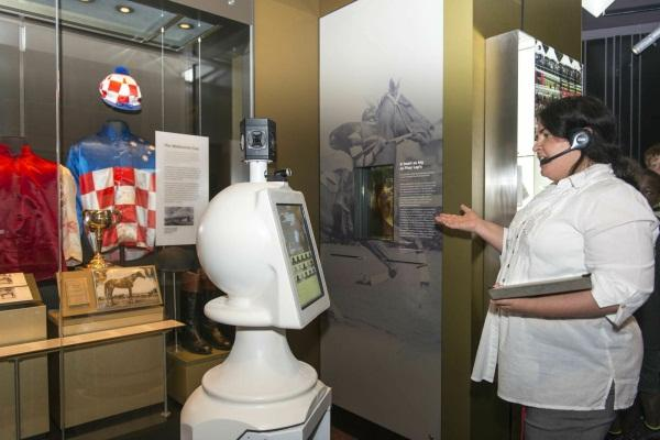 A museum educator walks through the museum exhibits