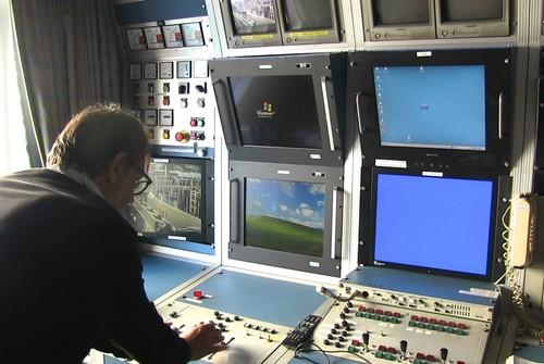 An engineer aboard the cable ship René Descartes describes its control systems for an ROV and trench-digging plow in Kitakyushu, Japan, July 9, 2015. The ship is laying down the 9,000-km FASTER Internet cable system between the US and Japan.