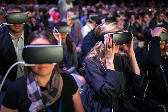 Facebook attendees watch virtual reality content in Gear VR headsets at a Samsung event in Barcelona on February 21, 2016.