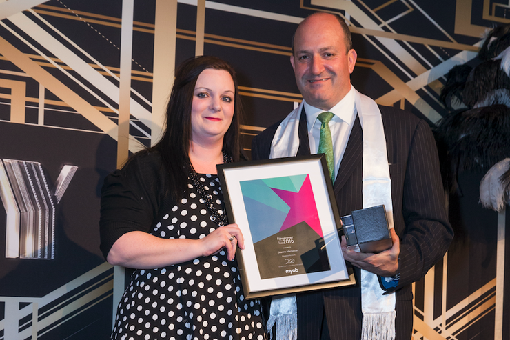 MYOB General Manager James Scollay presents Maraetai businesswoman Joanne Mankelow with MYOB's Newcomer of the Year Award at the company's prestigious partner awards event.
