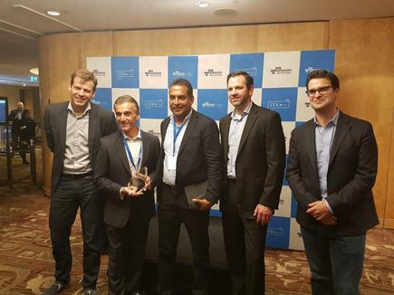 DiUS receiving the consulting partner of the year award with Stefan Jansen, Terry Wise and Paul Migliorini (AWS)