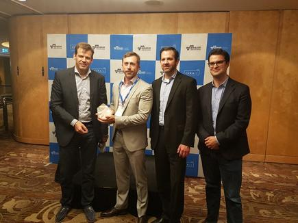 Paul Migliorini (right) with Stefan Jansen, Terry Wise, and Technology One receiving the AWS technology partner of the year 2016 award