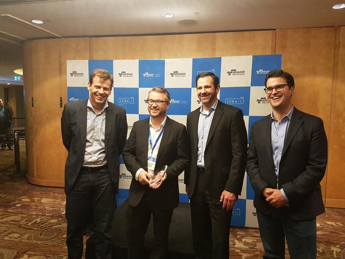 Comunet receiving the most innovative partner of the year award with Stefan Jansen, Terry Wise and Paul Migliorini (AWS)