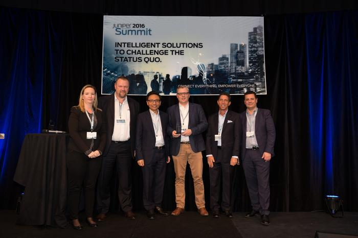 Source Central Partners CEO, Brendan Redpath (middle right), receiving the emerging partner of the year award at Juniper's partner summit in Sydney